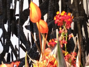 I loved this fiery flower arrangement in front of the charred wood. This is what we are called to, to be the flames of renewal upon the earth.