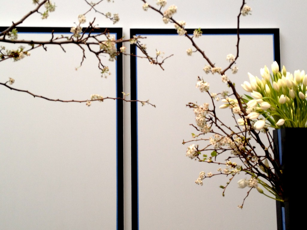 These blank canvases side by side spoke to my heart. I loved how the florist used the flowering branches to unite them. I felt my beloved standing next to me as our love flowers, closing the gap between us.