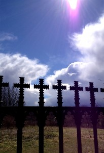 Sunlight streaming in, transforming the old patterns of suffering of the cross into the new patterns of joy.