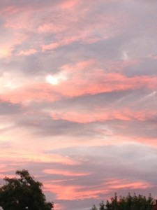 I imagine the pink clouds as a blanket of peace and love covering the earth.