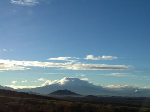 Mount Shasta blanketed by clouds.