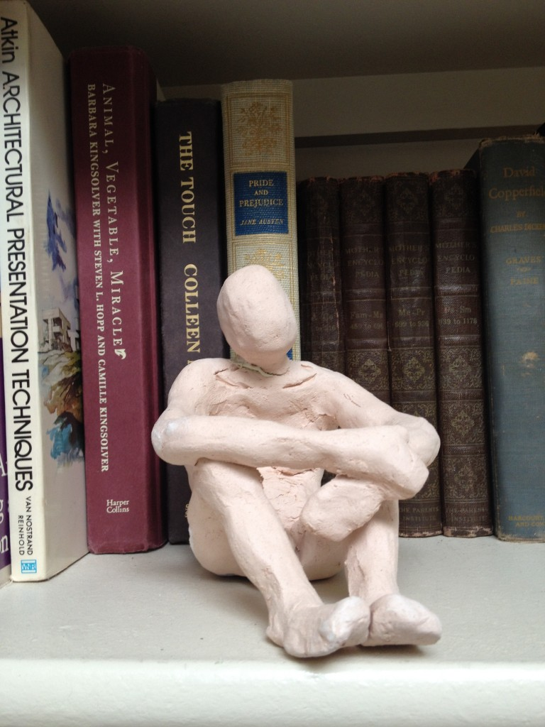 "One of my clay figures pondering, ""Who is she?"""
