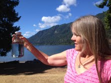 The crystal clear water of Lake Crescent that I bottled to add to waters along my journey. It felt so balanced on our skins, assisting in this process.