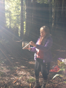 Playing the bowl in the redwoods.